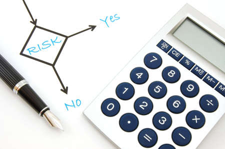 financial questions: risk management chart and pen showing business concept                                     Stock Photo