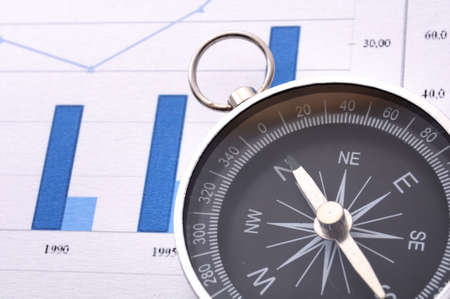 business concept with compass and diagram or chart photo