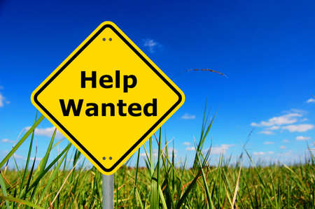 help wanted concept with yellow road sign and copyspace                                     photo