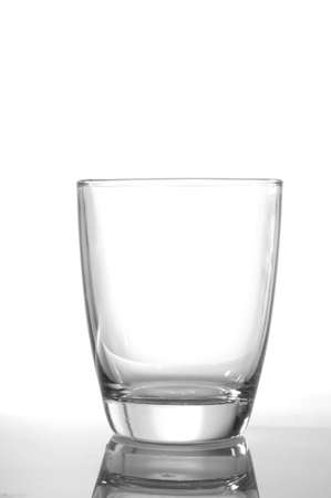 photo of pouring water and glass on white background Stock Photo - 5987076