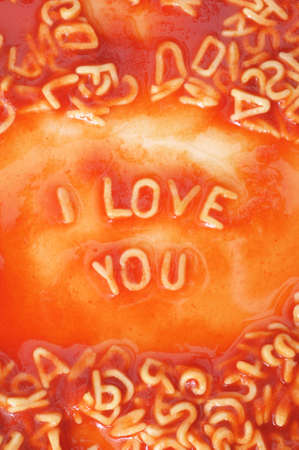 I love you concept with red pasta food photo