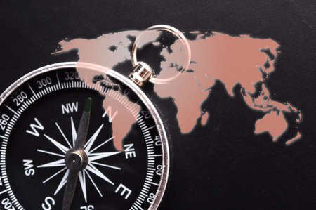 compass and world map showing travel or adventure concept
