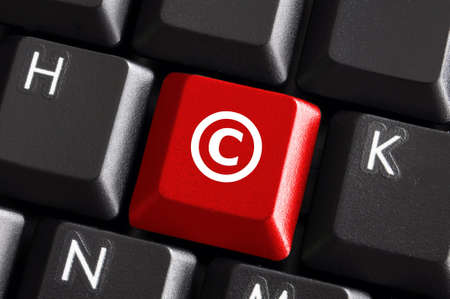 copyright concept with red button on computer keyboard photo