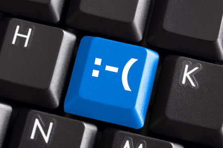 negative smilie on blue computer keyboard button showing bad feelings concept photo