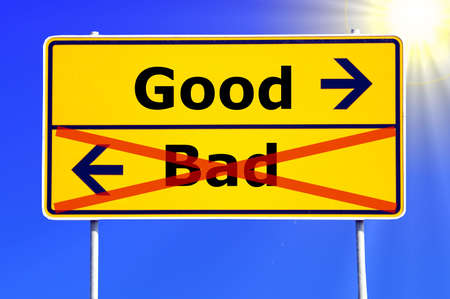 good and bad choice concept with yellow road sign                                   photo