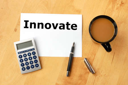 deviation: innovate or innovation business concept with coffee pen and paper in office