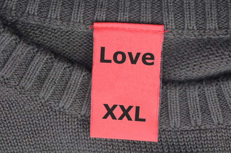 xxl: xxl love concept with label or tag in a shirt
