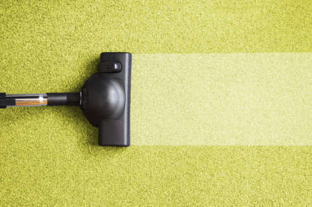 vacuum cleaner on the floor showing house cleaning concept                                      photo