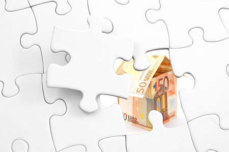 puzzle and house of money showing real estate concept                  Stock Photo - 6080426
