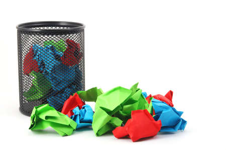trash or rubbish paper in basket isolated on white background photo