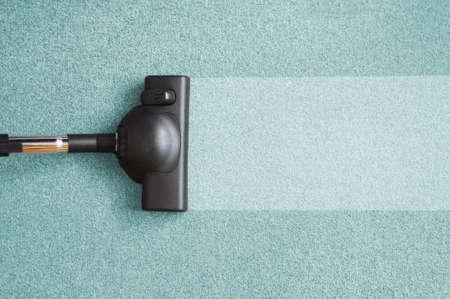 pulizia pavimenti: aspirapolvere e copyspace per testo messaggio  Archivio Fotografico