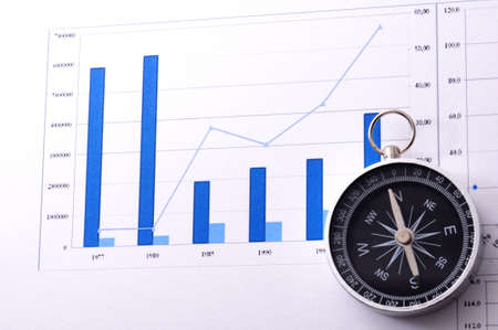business navigation concept with compass and diagram or graph photo