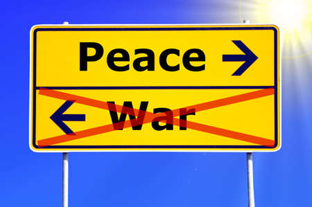 pacifism: peace and war concept with yellow road sign
