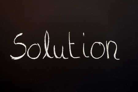 solution for a problem written on a chalk or black board                                     Stock Photo - 6157738