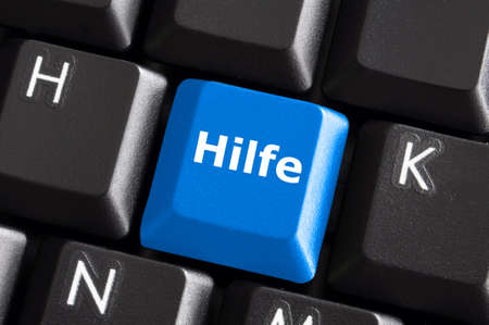 german word hilfe showing help or assistance concept with keyboard Stock Photo - 6198894