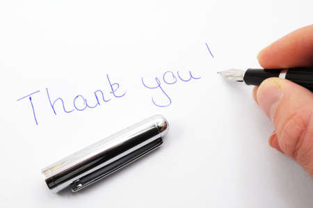 admire: thank you message on paper with pen