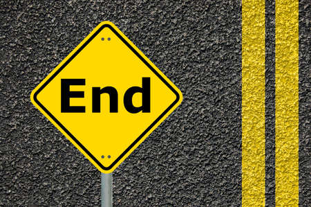 dead end: the end concept with warning  roadsign in yellow                                     Stock Photo