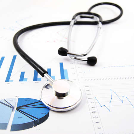 health information: stethoscope on medical data chart in hospital