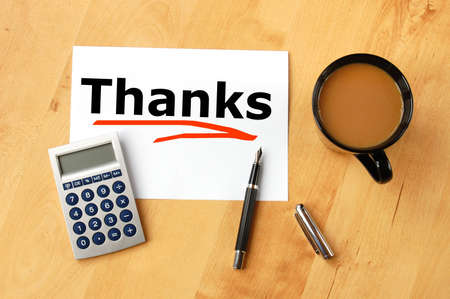 remark: thanks or thank you concept with pen paper and coffee in office Stock Photo