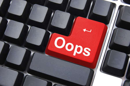 mistake: oops button on computer keyboard showing error or mistake concept