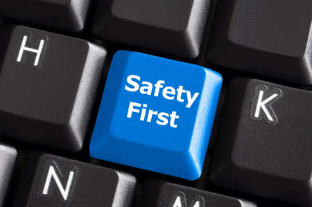 safety first concept with blue key on computer keyboard Stock Photo - 6306584
