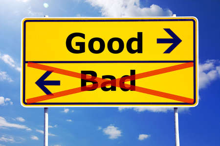 good and evil: good and bad choice concept with yellow road sign