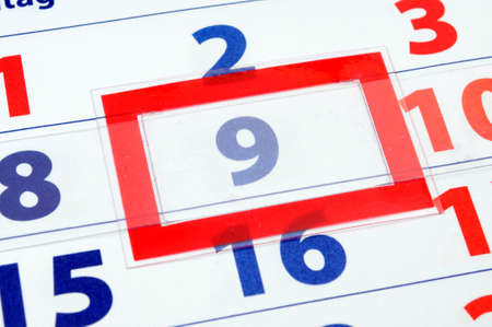 date of today shown by calendar with red pointer                                    photo