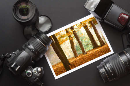 vacation or travel image concept with camera and lens photo