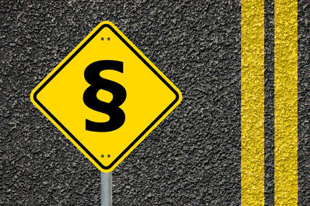 paragraph: law concept with paragraph on a yellow traffic sign                                     Stock Photo
