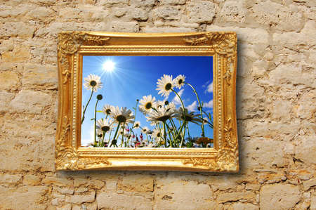 summer flowers and image frame on a wall  photo