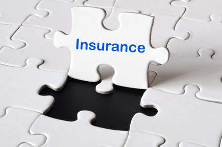 home insurance: insurance concept with white puzzle or jigsaw  Stock Photo