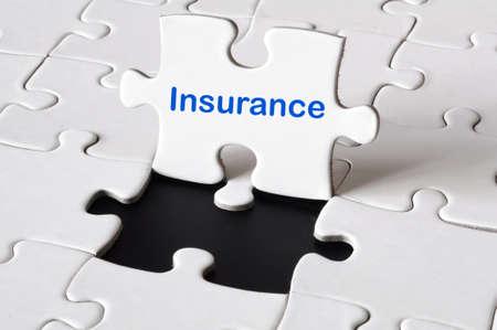 ubezpieczenia: insurance concept with white puzzle or jigsaw  Zdjęcie Seryjne