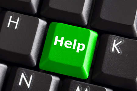 help support or assistance concept with green button on computer keyboard Stock Photo - 6565613