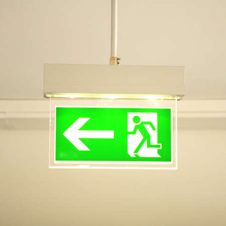 green emergency exit sign showing the way to escape Stock Photo - 6651864