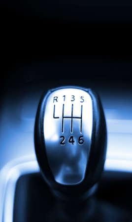 accelerate: gear shift from a modern sports car in metal design
