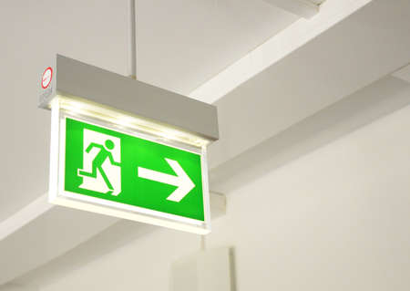 green emergency exit sign showing the way to escape Stock Photo - 6690372