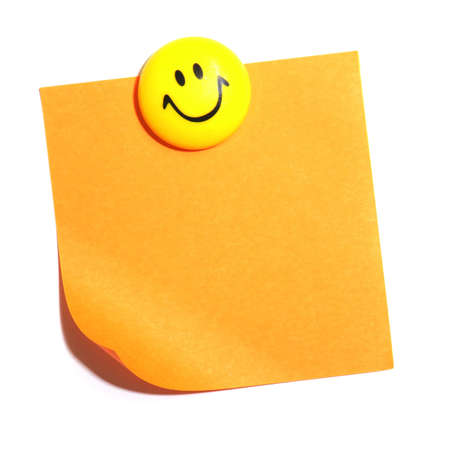 smiley and blank or empty sheet of paper with copyspace isolated on white photo
