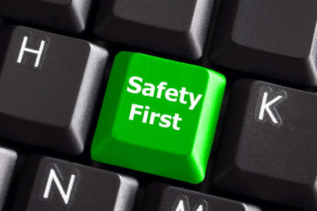 safety first concept with green key on computer keyboard photo