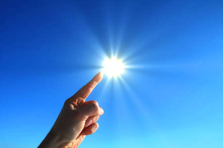 hand sun and blue sky with copyspace for text message Stock Photo - 6745037