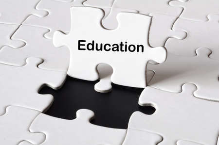 tuition: education or school concept with white puzzle  Stock Photo