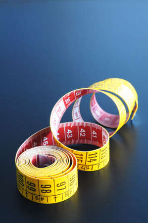 taylor: measuring tape showing diet or taylor concept