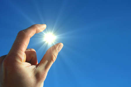 hand sun and blue sky with copyspace for text message Stock Photo - 6811090