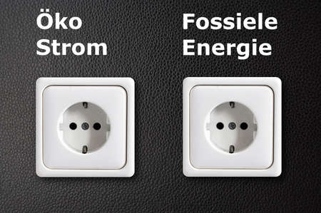 renewabel: alternative energy concept with power outlet on black background Stock Photo