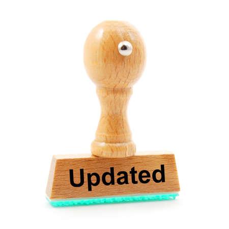 updated: sello actualizado en la Oficina de negocios mostrando el concepto de actualizaci�n Foto de archivo