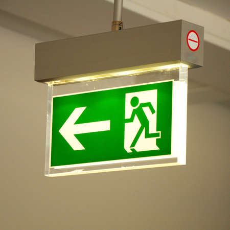 green emergency exit sign showing the way to escape  Stock Photo - 6995912