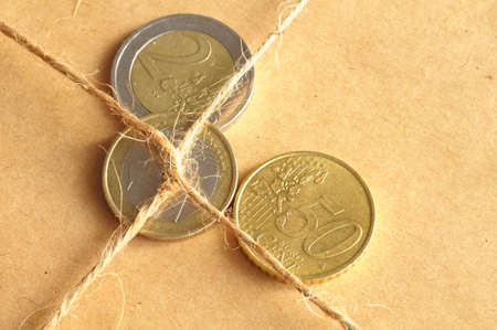 forwarding charges or shipping money concept with coins and parcel Stock Photo - 6995974