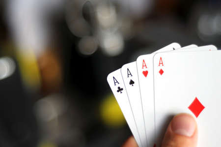 hand and four aces showing poker concept with copyspace