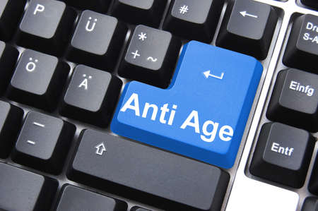 anti ageing: anti ageing computer button showing beauty concept                                     Stock Photo