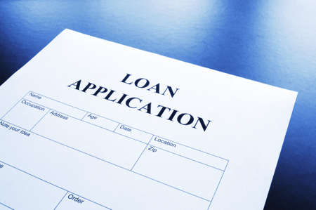 interest: loan application form or document in bank office showing finance concept Stock Photo