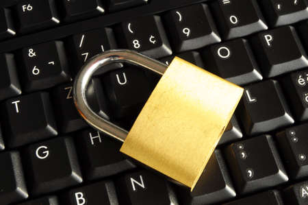 internet security concept with padlock on black keyboard photo